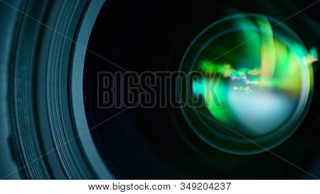 Macro Photography Of A Dslr Lens With A Colorful Glare