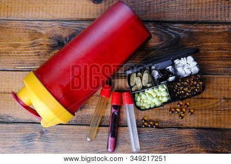 Steroid Medication And Sport Nutrition Composition On A Wooden Background