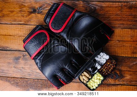 Mma Gloves And Steroid Medication With Sport Nutrition Composition On A Wooden Background