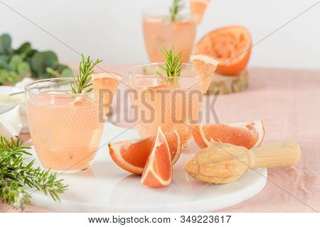 Grapefruit Juice With Rosemary In Glasses On The Table. Refreshing Summer Cocktail.