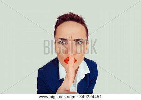 Angry Woman Wide Eyed Asking For Silence Or Secrecy With Finger On Lips Hush Hand Gesture Light Gree