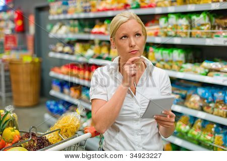 a woman is overwhelmed by the huge selection when shopping in a supermarket.