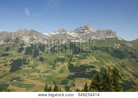 Swiss Mountains In The Background With Alps In The Foreground On A Sunny Summer Day In Switzerland