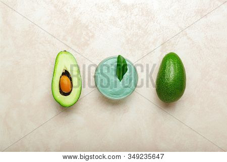 Avocado Face Mask In Glass Jar With Leaves And Avocado. Homemade Nourishing Mask Made From Mashed Av
