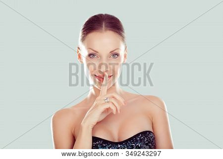 Hush. Woman Smiling Wide Eyed Asking For Silence Or Secrecy With Finger On Lips Shh Hand Gesture Lig