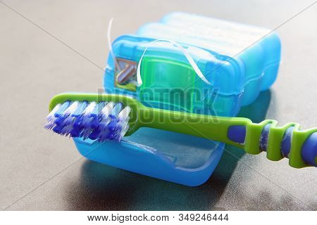 Tooth Brush And Floss. Used Toothbrush And Floss.