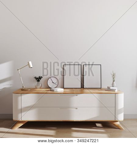 Blank Photo Frames In Modern Scandinavian Style Interior On Beautiful Chest Of Drawers With White Wa