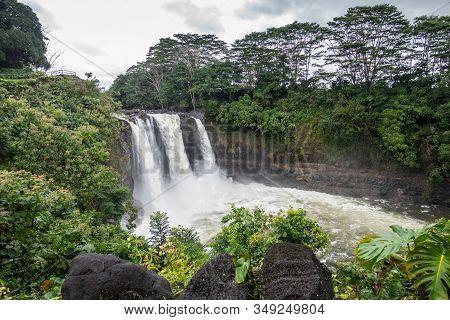 Hilo, Hawaii, Usa. - January 14, 2020: Longer Shot On White Rainbow Falls On Foaming Violent Wailuku