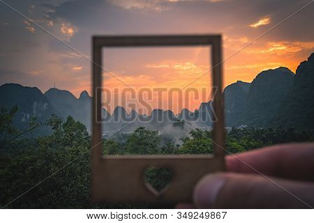 Beautiful Impressive Karst Mountain Landscape In Yangshuo At Dusk Seen Through The Small Picture Fra