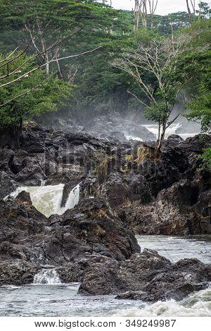 Hilo, Hawaii, Usa. - January 14, 2020: Closeup Of White Water And Lava Rocks On Wailuku River Surrou