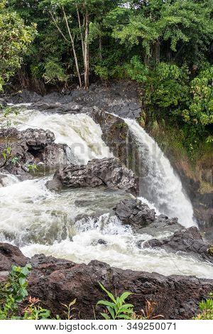 Hilo, Hawaii, Usa. - January 14, 2020: Closeup Of White Water And Lava Rocks On Edge Of Rainbow Fall