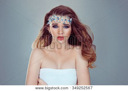 Sexy And Beautiful. Beauty Queen Bride Woman With Bright Blue Crystals Jewelry On Head Looking At Yo