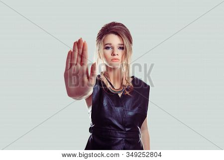 Stop Right Here. Angry Annoyed Displeased Young Woman Raising Hand Up To Say No, Stop Isolated Light