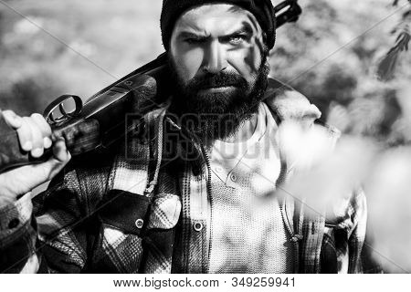Poacher In The Forest. Hunting Licenses. Hunting Is The Practice Of Killing Or Trapping Animals. Hun