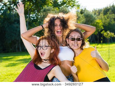 Girls Posing For Portrait In Funny Way.
