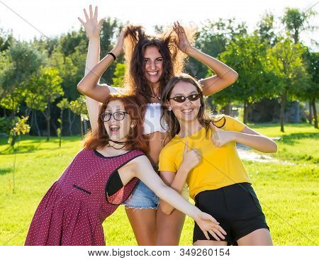 Group Of Three Happy Young Women Celebrating.