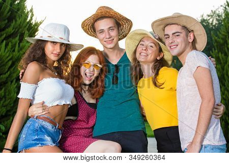 Group Of Smiling Young Party Friends Fooling Around.