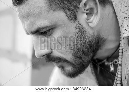 Male Portrait In Sadness. Mans Fashions. Handsome Man Closeup Portrait. Stylish Latin Man. Handsome