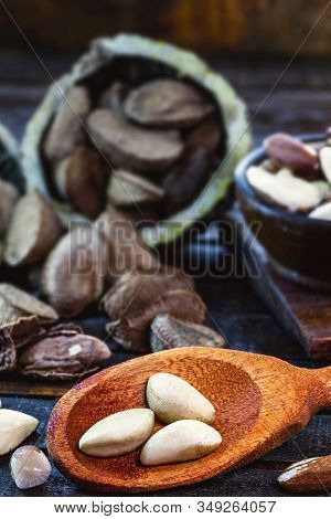 Peeled Brazil Nut. Brazil Nuts, Rustic Wood Background. The Chestnut Is The Seed Of The Chestnut Tre