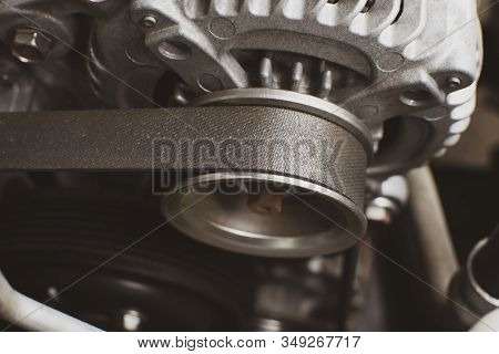 Timing Belt Of Old Alternator In Engine System Of Car, Automotive Part Concept.