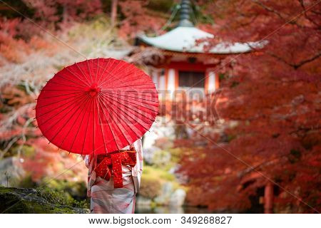 Young Japanese Girl Traveller In Traditional Kimino Dress Standing In Digoji Temple With Red Pagoda