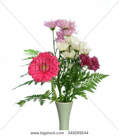 A Bouquet Of Daisy Flowers And Gerbera In Vase Isolated On White