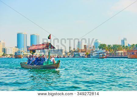 Dubai, OAE - January 31, 2020:  Traditional Abra boat with passangers at the Creek bay in Bur Dubai, United Arab Emirates