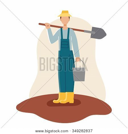 A Male Gardener In A Yellow Hat, Boots, And Blue Robe Holds A Shovel And Bucket. Spring Planting.gar