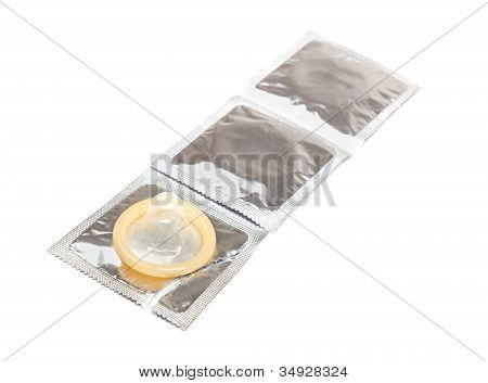 Three Condoms On White Background