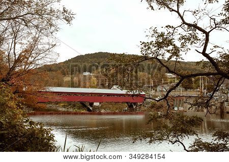 Woodstock, Vermont - September 30th, 2019:  Historic Taftsville Covered Bridge Surrounded By Fall Fo