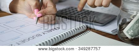 Focus On Plan Of Income Distribution By Couple. Man And Woman Dealing With Financial Issues Looking