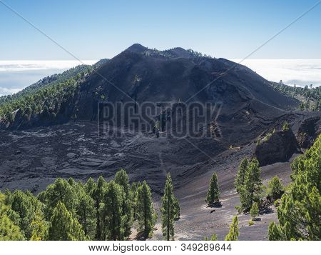 Volcanic Landscape With Lush Green Pine Trees, Colorful Volcanoes And Lava Crater Deseada Along Path