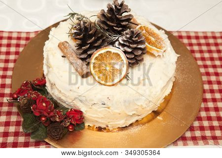A Traditional British Christmas Cake A Traditional British Christmas Cake Decorated With Oranges, Ci