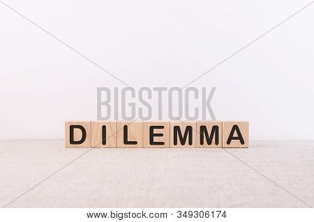 Dilemma Word From Building Blocks On A Light Background