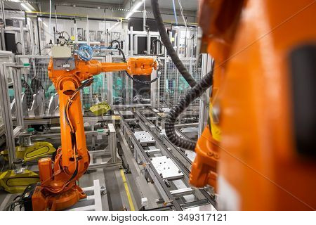 Automatic Robots In The Industrial Factory For Assembly Automotive Products, Automotive Concept