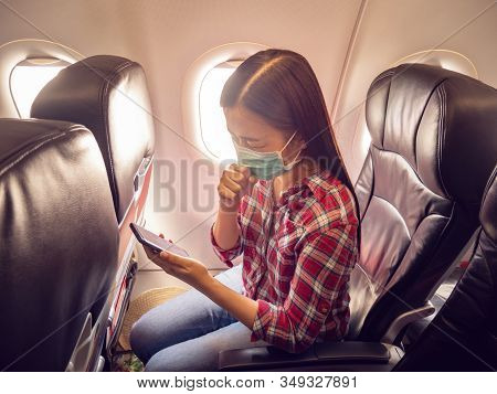 Asian Tourist Feeling Sick, Coughing ,wearing Mask To Prevent During Travel Time By Airplane For Pro