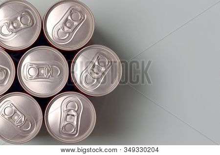 Many New Aluminium Cans Of Soda Soft Drink Or Energy Drink Containers. Drinks Manufacturing Concept