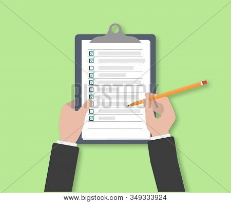 Clipboard With Checklist Icon. Businessman Holding A Pencil Completed Checklist On Clipboard. Busine