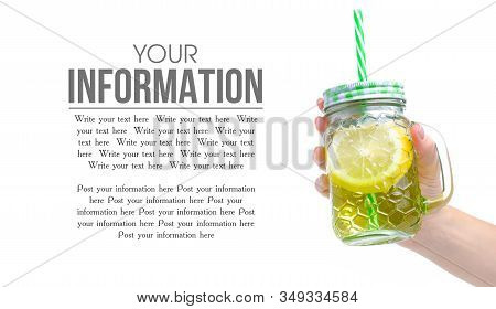 Jar Glass With Lemon Water In Hand On White Background Isolation, Copy Space