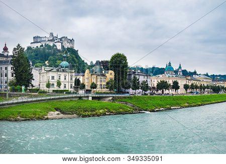 Beautiful View Of Salzburg Skyline With Festung Hohensalzburg And Salzach River In Salzburg, Austria