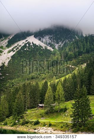 Austrian Alps, Gosauseen Or Vorderer Gosausee Lake In Austria, Europe. Foggy Mountain Summer Landsca