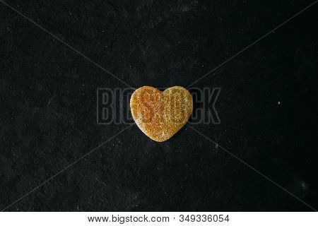 Heart Shaped Candy On Black Slate Background. Sugary Candy As Texture And Background For Design. Lov