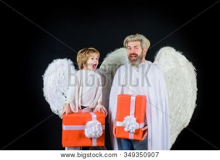 Christmas Angels. Valentines Day. Little Cupid Boy Gives Father Gift. Father's Day. Gift Box. Happy