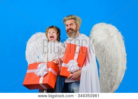Father And Son Angels. Christmas Angels. Valentines Day. Little Cupid Boy Gives Father Gift. Father'
