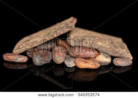 Lot Of Whole Fresh Brown Cocoa Bean Two Bars With Cocoa Butter Isolated On Black Glass