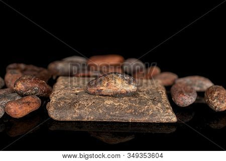 Lot Of Whole Fresh Brown Cocoa Bean With Cocoa Butter Isolated On Black Glass