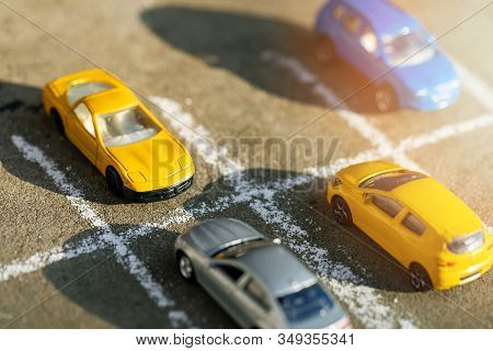 Toy Cars On Parking Lot On Sunny Day