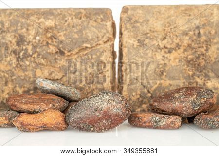 Lot Of Whole Fresh Brown Cocoa Bean With Cocoa Butter Isolated On White Background