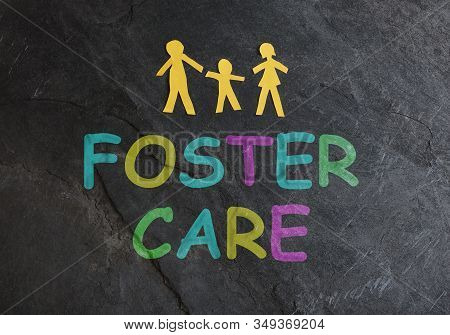 Paper Family Of Three With Foster Care Spelled In Colorful Letters