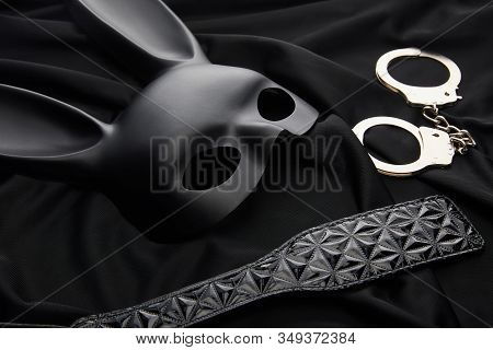 Rabbit Mask And Sex Toys On Black Textile Background